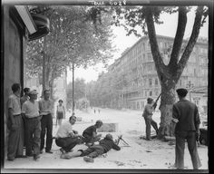French Resistance fighters exchange fire with German troops in Marseilles during the German withdrawal from the city, Aug 1944. The resistance was a major force during the liberation of France cooperating closely with invading Allied forces.