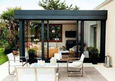 Glass and metal for pergola on roof