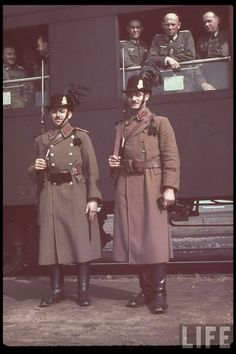 Hungarian soldiers pose for a photograph as their German Wehrmacht allies depart for the Reich via train.