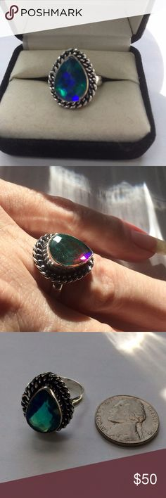 🎀STERLING SILVER 🎀🎀BLUE MYSTIC HANDCRAFTED RING Beautiful Sterling Silver Handcrafted Size 8 Blue Mystic changes color in the light very pretty. NWOT handcrafted Jewelry Rings