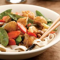 Lemon Chicken Stir-Fry  Spiked with lots of zesty lemon, this delectable chicken stir-fry has a colorful mix of snow peas, carrots, and scallions.