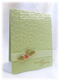beautiful Christmas card (certainly celery base, holly berry uses real red and cherry cobbler);  Snow Globe embossing folder by Sizzix