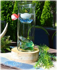 As promised in my previous post, here is a simple tutorial on how to create a fishing themed centerpiece in a cylinder vase. I& had som. Fish Centerpiece, Party Centerpieces, Table Decorations, Dad Birthday, Birthday Parties, Birthday Ideas, Surprise Birthday, 50th Party, Retirement Parties