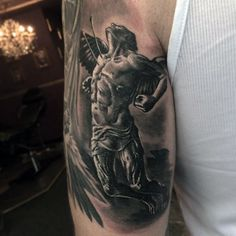 Male Forearms Black And Grey Tattoo Of Winged Man Being Hit