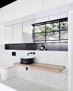 Agape Design Vieques counter top basin by Patricia Urquiola #AgapeDesign #PatriciaUrquiola #AgapeBathrooms @agapebathrooms #Repost @designstuff_group ・・・ // We promised you more of that AMAZING Bathroom with Concealed Laundry by @the_northbourne_effect and here it is :) You know what's behind all that sexy mirror? 5 cavernous cabinets ...Storage, storage, storage baby ;) GAH. Oh and y'know how much we love our storage!! ;) Photo by the lovely @evegwilson. Team DS. X #designstuff #bathroom…