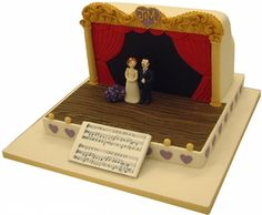 Theatre stage The main part of the theatre is made from cake. The raised boards are made from a shallow iced dummy, but cake could be used if extra portions are required. The bride and groom are sugar models dressed for a theatrical production. The musical score can be of your choice or replaced with a suitable inscription