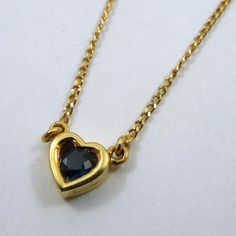 """Contemporary 18k Yellow Gold 20"""" Necklace with a Small Gold Heart Containing a Round Cut Topaz. $210"""