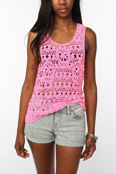 i love this tank for may reasons....   1. its so bright  2. youre getting away with being half naked  3. there are 3 indian jones temple of doom skulls secretly crocheted into the shirt  4. i could see myself wearing it (i swear it has nothing to do with the model)
