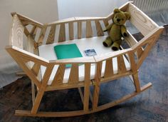 The Rocking Cradle by Martin Price is a clever one: When it is out of commission you'll retain 2 rocking chairs!