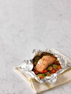 steamed salmon with zucchini, tomato, and basil
