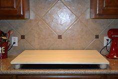 How To: Stove Top Cover for Added Buffet Space.  I would like this custom-made to match counter top-surface.