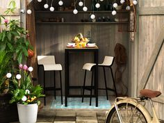 """Not just a shed"" outdoor rooms inspiration from Ikea:    Transform a shed into a romantic date spot with cordless lighting and comfortable, stylish outdoor furniture."