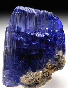 Tanzanite. Trichroic variety of ziosite. Appears bluish under fluorescent light and purplish under incandescent light. Found mostly in Mt. Kilimanjaro.