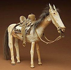 Navajo horse, ca. 1930 Wood, leather, wool, horsehair, metal nails Height 11 inches; length 13 inches Gift of J.O. Brew Wheelwright Museum of the American Indian, Santa Fe.jpg