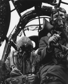The crew of a German Ju-88 medium bomber during flight.