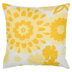 White throw pillow with a yellow swirling sun motif.     Product: PillowConstruction Material: Polyester cover and fib...