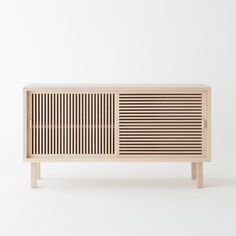 leibal:Buffet Kyoto is a minimalist design created by France-based designer Colonel. The partition based sideboard was inspired from partitions found in Ryokan: traditional Japanese inns. As the doors slide over each other, they form a set of grid-lines. The piece is made in solid beech, and comes in grey, yellow, or natural.
