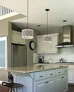 Love the white cupboards and subway tile