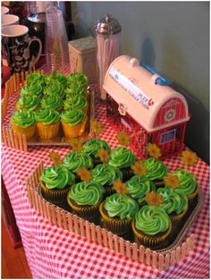 """Cupcakes as green grass w/flowers in a """"fence"""" in front of a barn....cute and not as expensive as a huge cake ;)"""