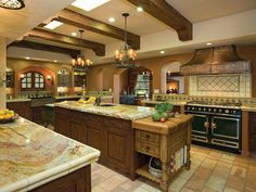 Hacienda HomeStandout structural and decorative elements such as arched entryways and openings, exposed ceiling beams and wrought-iron fixtures with authentic detailing set the tone for this sunny, comfortable and expansive hacienda-style kitchen. Requirements of the clients were fulfilled in a large preparation area for her, convenient access to the breakfast prep space for him, as well as an overall user-friendly approach for the children. Story: This kitchen features meticulous detail…