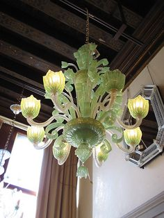 This almost looks like green milk glass. Which sound like green silk grass. What a lovely color. The bulbs give the glass a newly budding feel. -- Malone