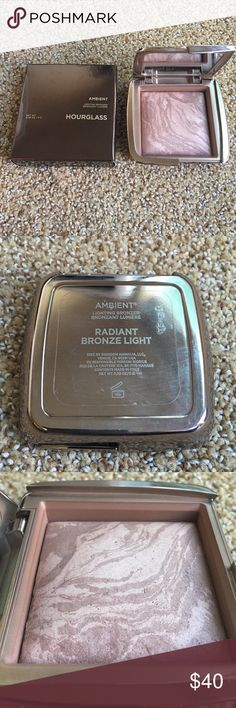 Nearly new hourglass ambient bronzer. Radiant Bronze Light- a warm bronze shade fused with Radiant Light, a golden beige powder, to mimic a summer glow.  Beautiful bronzer only used a few times. Hourglass Makeup Bronzer