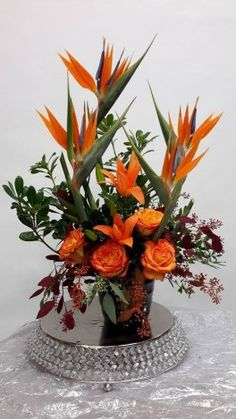 A Birds of Paradise blue orchids roses lilies 4