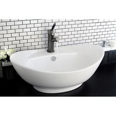 @Overstock.com - Oval Vitreous China White Bathroom Vessel Sink - Bring added elegance to your bathroom with the graceful lines of this white vessel sink. Constructed of durable and stain resistant vitreous china, this vessel sink arrives with a hole to mount a faucet and built-in overflow.  http://www.overstock.com/Home-Garden/Oval-Vitreous-China-White-Bathroom-Vessel-Sink/6511195/product.html?CID=214117 $106.99