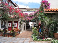 Worth Avenue, Palm Beach , Palm Beach FL, influenced by Spanish Colonial, the little vistas must be seen with flowers everywhere