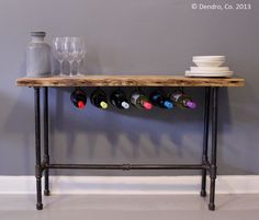 Bar table with wine rack. Would coordinate with a similar-finished, same-style coffee table from the same shop.