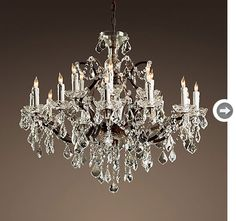 Crystals mix with new/old tech with these electric chandeliers designed to mimic candlelight.