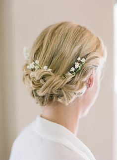 Elegant Updo with a Few Sprigs of Lily of the Valley | Janet Dunnington Destination Weddings https://www.theknot.com/marketplace/janet-dunnington-destination-weddings-sunderland-vt-218802 | KT Merry Photography https://www.theknot.com/marketplace/kt-merry-photography-aventura-fl-270180