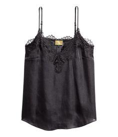 Black. Satin camisole top. Narrow, adjustable shoulder straps, V-neck, and wide…