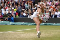 Ladies' Quarter-Finals Sabine Lisicki forced wide to return a backhand. - Matthias Hangst/AELTC