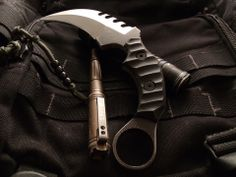 "James Coogler's Kratos Karambit - Weight: 8.7 oz Overall Length: 10"" Blade Length: 5"" Blade Material: N690 Stainless Steel Thickness: .250"" Blade Grind: Hollow, Double Edged, Deep Serrations Handle Length: 5"" Handle Material: Hand Textured Black G10 Scales Sheath: Static Cord Carry Kydex Sheath.  $649.99"