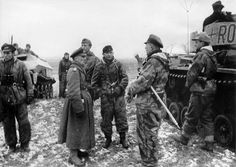 For his display of exceptional leadership, Oberst Adelbert Schulz was promoted and given the command of 7. Panzer-Division on 26 January 1944. Here Generalmajor Schulz is standing in the middle of the group, third from the right. To the left of him is General von Manteuffel and to his right is Oberst von Steinkeller. The tank seen at the right is the command version of the Pz.Kpfw. III with tactical markings typical for the staff of a Panzer regiment.