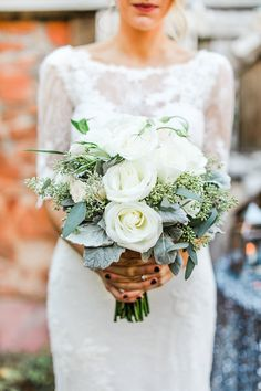 winter wedding bouquets - photo by Deisy Photography http://ruffledblog.com/winter-wedding-inspiration-with-pine-cones