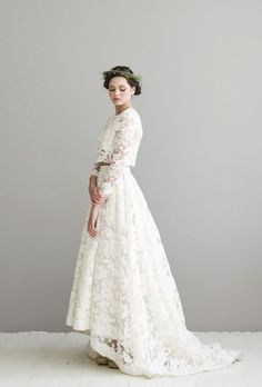 Chic two piece long-sleeve lace wedding dress; Featured Dress: Houghton Bride, Featured Photographer: Angela & Evan