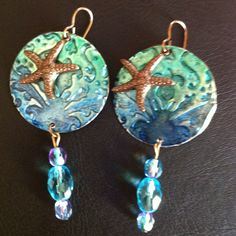 Hand crafted earrings using sizzix big shot, vintaj embossing and Tim holtz inks... Hope mom likes them for mothers day...