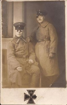 Wounded German soldiers posing for a studio photograph, 1914.