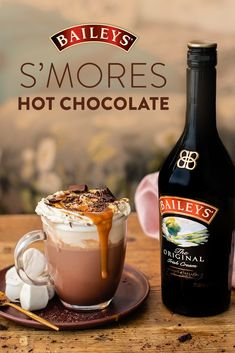 Toasty, roasty, and oh so cozy. Get it all in one cup of S'Mores Hot Chocolate. Baileys Drinks, Bar Drinks, Cocktail Drinks, Yummy Drinks, Cocktail Recipes, Alcoholic Drinks, Beverages, Cocktails, Christmas Drinks