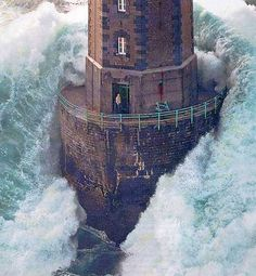 lighthouse in the middle of a storm