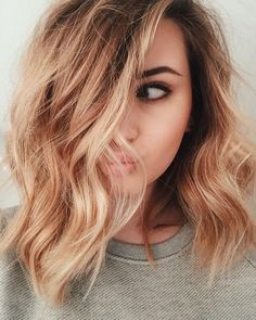Mid length lob bronde blonde side parting long fringe tousled waves