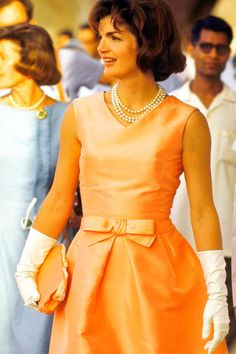 Jackie Onassis - Cocktail dress with white gloves