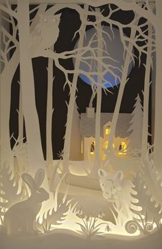 The Magic Cupboard / snowy papercut scene lit by LED's & fibre-optic lights. The stars actually twinkle & the glowing windows of the cottage look so cozy.