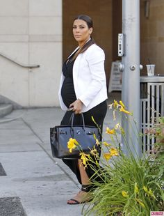 Pregnant Kim Kardashian Goes Black and White for Dinner in Beverly Hills.