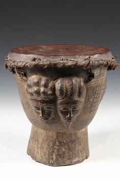 AFRICAN DRUM - Baule People, Ivory Coast, Bandama River Region, Wedding Drum carved with faces of couple apart and together, with hide drum head, fibre and thong binding, 19th c.