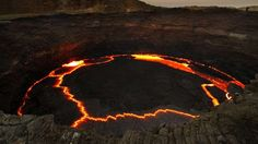 """Erta Ale lava lake One of the world's strangest lakes is found at the summit of Ethiopia's Erta Ale volcano—a molten lava lake that overflows on a regular basis. This explains the name of the mountain—Erta Ale means """"smoking mountain"""" in Afar.See the photo on Flickr"""