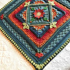 """The Riebeek-Kasteel Weekend Block is another in a series of large floral-themed, super-textured crochet blocks inspired by my beloved country, South Africa. This pattern includes a 24""""/60cm square frontispiece and an 8"""" /20cm square. These 24"""" /60cm and 8""""/20cm blocks were designed to be multi-functional. They can be used as a single central panel or repeats for a blanket of any size. Four 24""""/60cm repeats will make a baby blanket, eight repeats, a lapghan or throw, t..."""