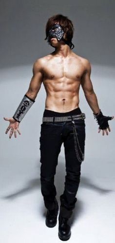 Shirtless Daesung with mask on